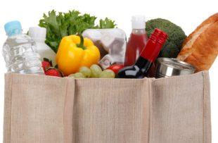 Reusable shopping bag full of groceries.