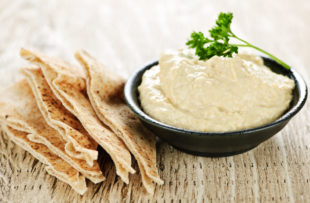 """Try something new this year and make your own hummus. Made from five simple ingredients, its name in Arabic literally translates to """"chickpeas."""" These cream-colored beans are full of protein and rich in fiber. Tahini is ground sesame seed paste that adds creaminess and a distinctive nutty flavor. Hummus can be served with pita bread or used as a dip for raw veggies like carrots, celery and bell pepper slices."""