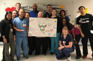 Staff of Sunrise Hospital hold a sign thanking their counterparts at Tidelands Georgetown